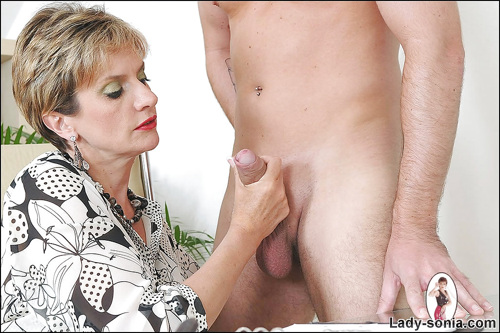 Woman holding naked man dick